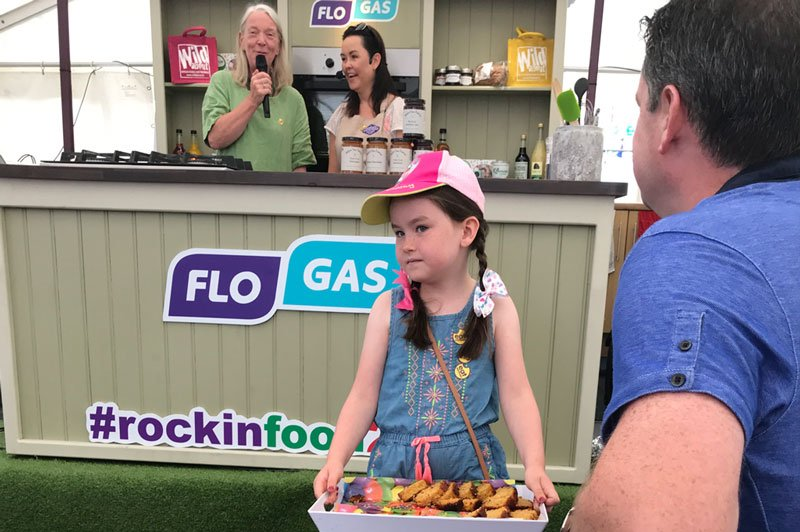 Lila Helping Out at Rockin Food Festival